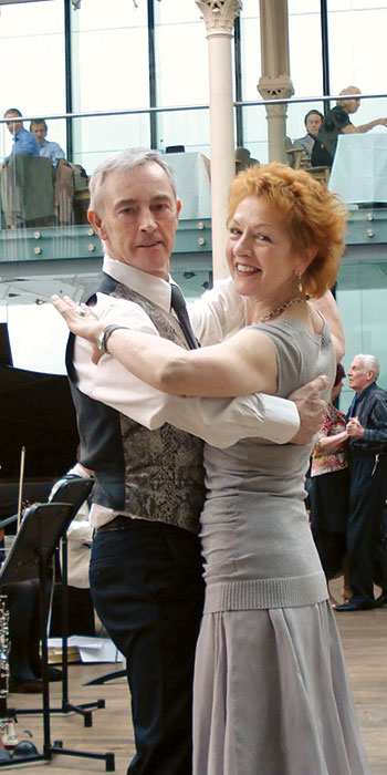 Jane and partner dancing in the Paul Hamlyn Hall (formerly the Floral Hall) at the Royal Opera House, Covent Garden, London.