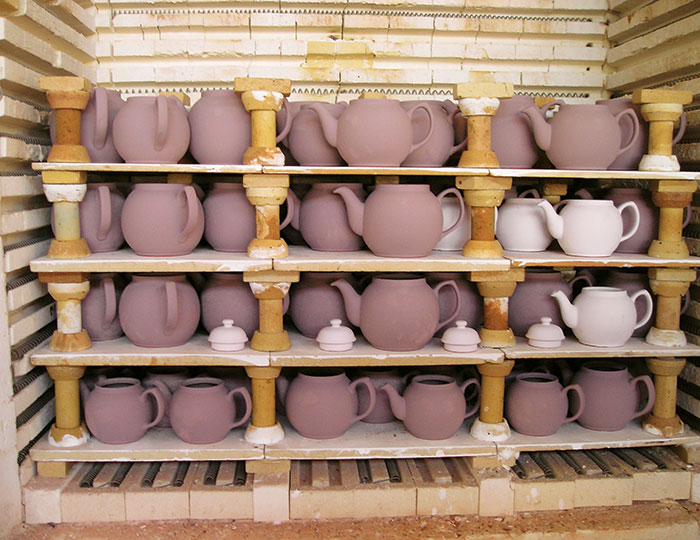 Brown Betty teapots ready to be fired a second time.