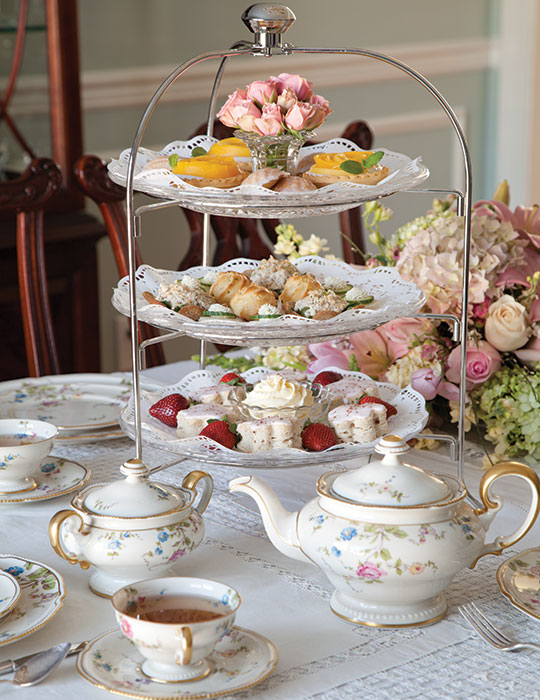 A Beautifully Set Table And Scones Tea Sandwiches Sweets Presented On Three Tiered Tray Are Two Of The Hallmarks An Afternoon