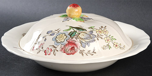 920s Spode Gainsborough design muffin dish decorated with peonies, tulips, and other English flowers.